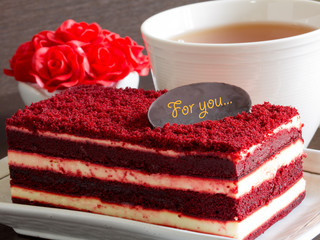 Red velvet cake with a cup of tea