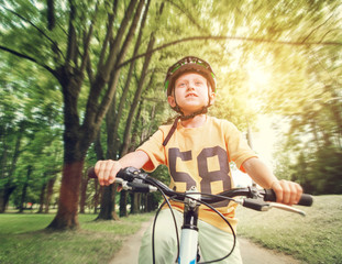 Boy ride his bicycle