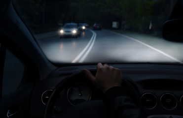 Fototapete - Driving at night with a car with xenon lights