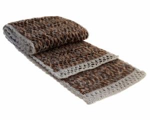 Knitted woolen scarf.