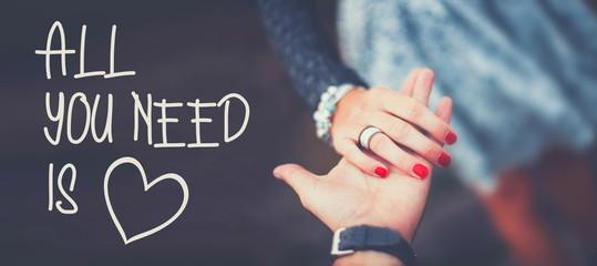 """Romantisches Hintergrundbild mit """"All you need is Love"""" Schriftzug"""