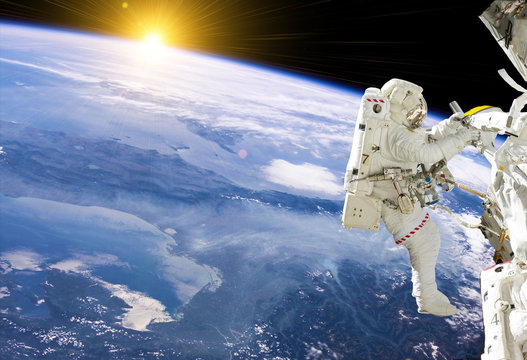 Astronaut in space on station - elements of this image furnished by NASA