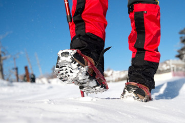 View of walking on snow with Snow shoes and Shoe spikes in winte