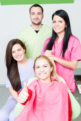 Happy patient and dental team