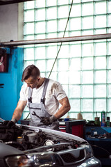 Repairman laboring in workshop