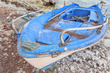Old blue wooden shabby fishing boat