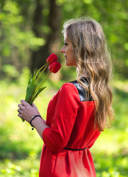 Beautiful woman and tulips