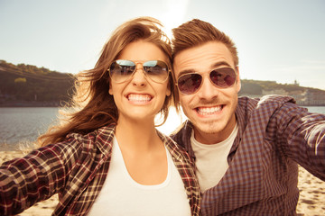 Two lovers making funny selfie