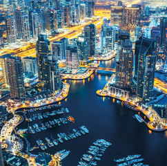 Dubai Marina skyline by night with lluminated architecture. United Arab Emirates.