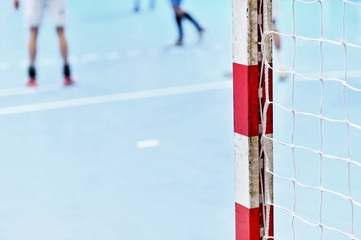 Handball goalpost with players in background