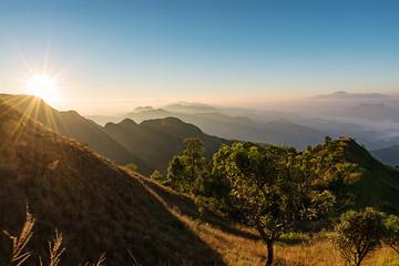 mountain ridge with mist and bright sunny in summer morning, Beautiful mountain ridge for hiking at Doi Tu Lay (Mon Tu Lay) , Tak province Thailand
