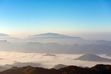 mountain ridge with mist  in autumn morning, Beautiful mountain ridge for hiking at Doi Tu Lay (Mon Tu Lay) , Tak province Thailand