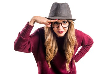 Hipster young girl showing something