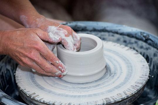 Famous potter use hands molds utensils