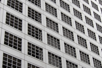 Perspective and underside angle view pattern of office building windows background.
