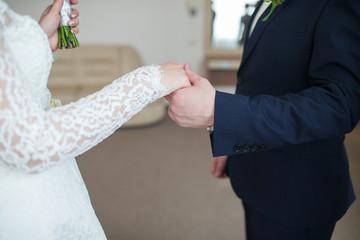 holding hands newlyweds