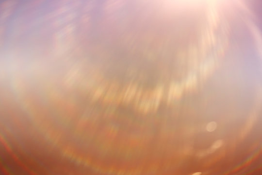 soft warm light rays, sun glare background