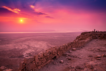 Wall Murals Candy pink Beautiful sunrise over Masada fortress. Ruins of King Herod's palace in Judaean Desert.