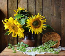 Still life with sunflowers and gooseberry.