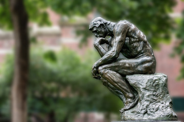 Thinker copper statue at university philosophy building
