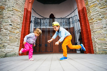 Little boy and girl dancing on stage in  Park.