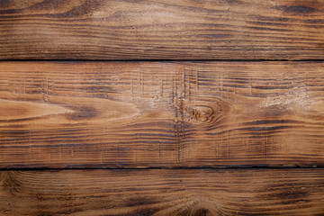 Old wooden burned table or board for background. Space for text
