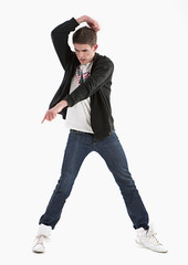 Young guy is dancing. Street dance. White background.