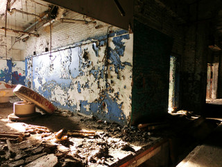 Abandoned crumbling factory warehouse restroom - landscape color photo