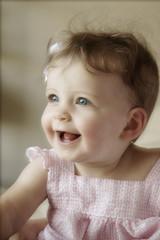 Smiling Happy Baby Girl wearing pink