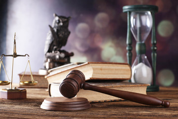 Law theme, mallet of judge, wooden gavel, books