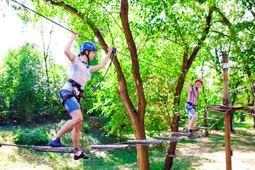 adventure climbing high wire park - people on course in mountain