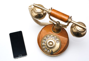 Old vintage phone and new modern smartphone