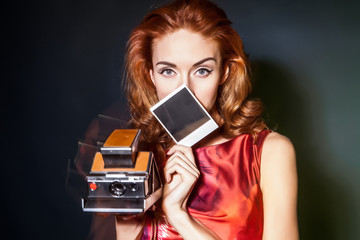 Girl with retro style instant camera.