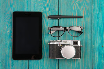 Notepad, camera, glasses and pen