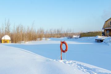 Frozen village pond