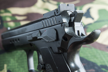 Firearm Pistol  on military camouflage background