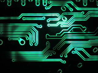 Green glowing patterns of a printed circuit board