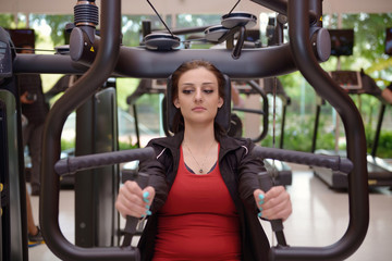 Young woman wroking out in a Gym
