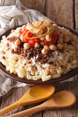 Vegetarian food: kushari of rice, pasta, chickpeas and lentils close up
