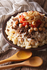 Egyptian Cuisine: kushari close-up on the plate. Vertical
