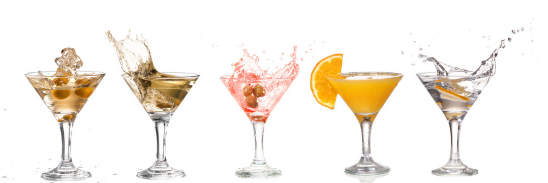 A martini glass on a white background; alcohol cocktail set with splash isolated on white; horizontal format