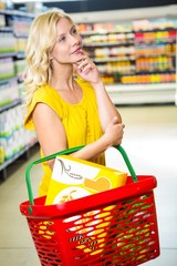 Thoughtful woman with basket