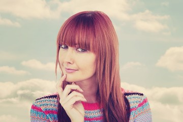 Composite image of portrait of a smiling hipster woman