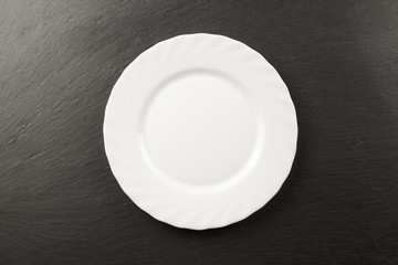 white plate on a black background. Table setting