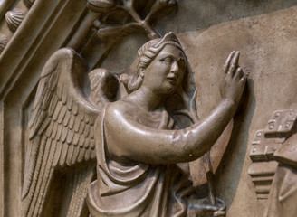 The bas-relief with the image of an angel