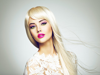 Portrait of beautiful blonde woman with pink make up