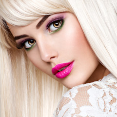 Beautiful  woman with pink make-up and long white straight  hair