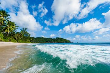 Closeup of Indian Ocean waves in Seychelles beach, Mahe island.