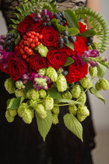 Wedding bouquet consists hop and roses