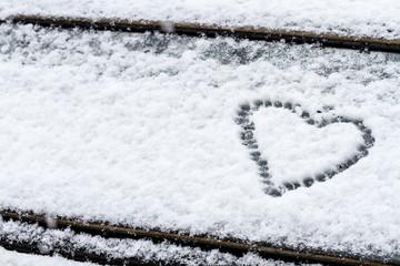 Heart symbol on a car windshield.